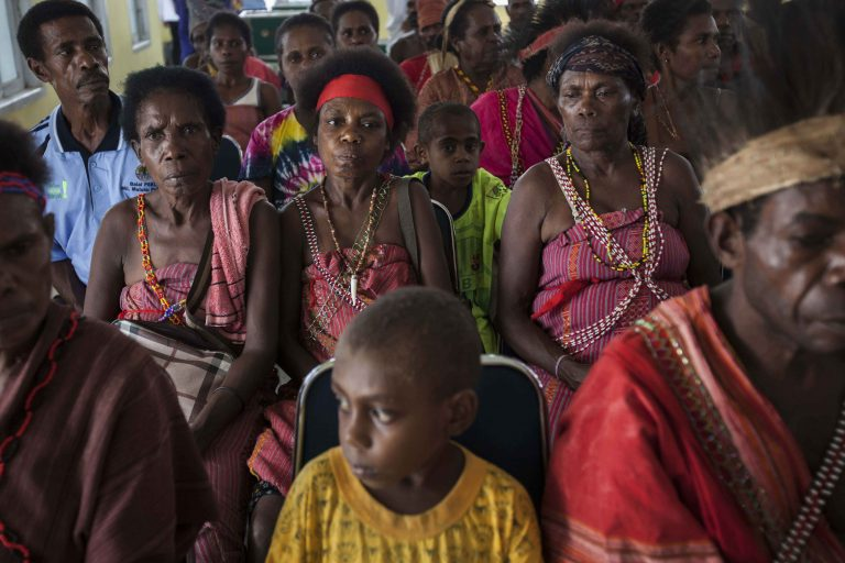 Papuanese tribes attend the handover ceremony of a social forestry permit in Teminabuan, South Sorong, West Papua. Two villages in South Sorong, Mangroholo and Sira, officially received a permit from the government to manage social forestry in their area. Photo by Jurnasyanto Sukarno / Greenpeace.