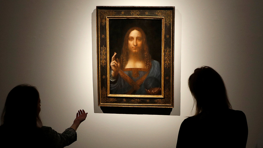 Members of Christie's staff view Leonardo da Vinci's Salvator Mundi painting. Credit: Reuters