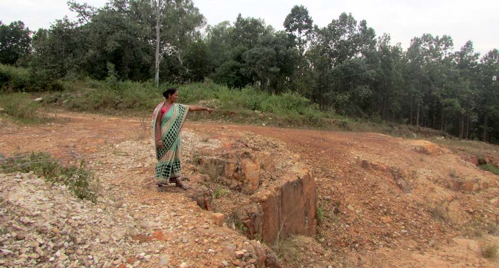 Sarojini, one of the widows, pointing at the mining area. (Photo by Rakhi Ghosh)