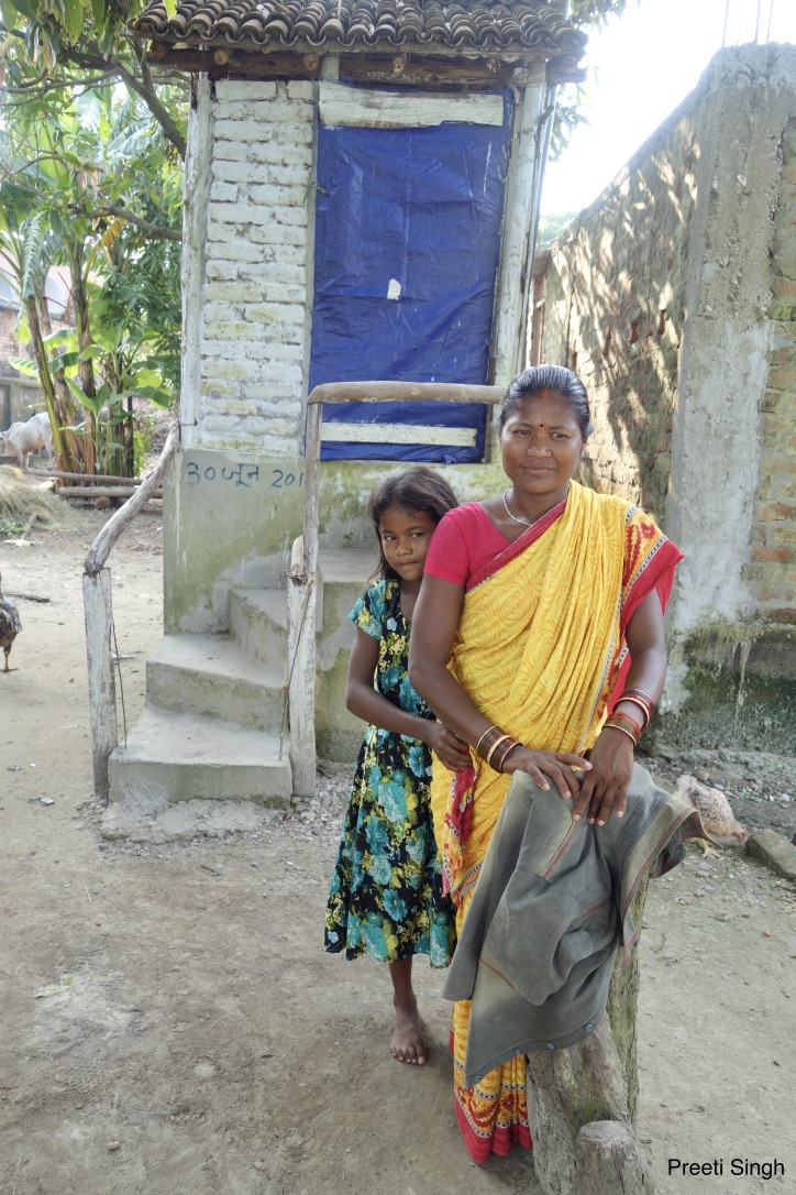 Puneeta Devi, a resident of Kairi village in Gaunaha block of Pashchim Champaran, has invested Rs 17,410 to build her own Phaydemand Shauchalaya. Her 12-year-old daughter, Reema Kumari, is most happy with the decision. Credit: Preeti Singh