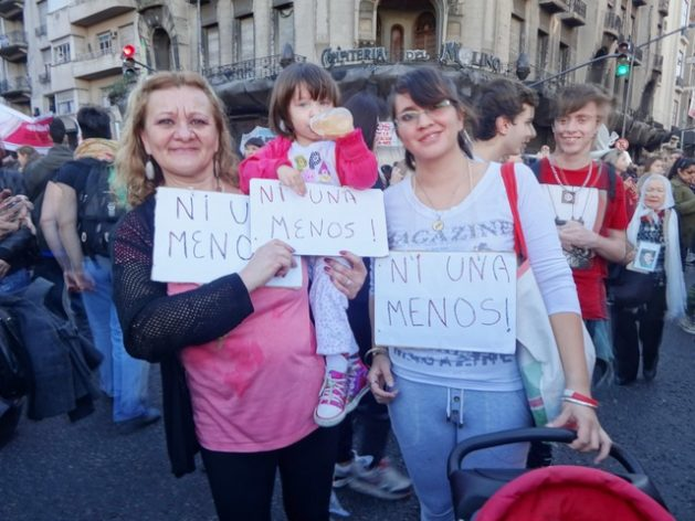"""Three generations of women from an Argentine family hold posters with the slogan """"Ni Una Menos"""", which means """"Not one [woman] less"""", in one of the demonstrations against femicides in Buenos Aires. Credit: Fabiana Frayssinet / IPS"""
