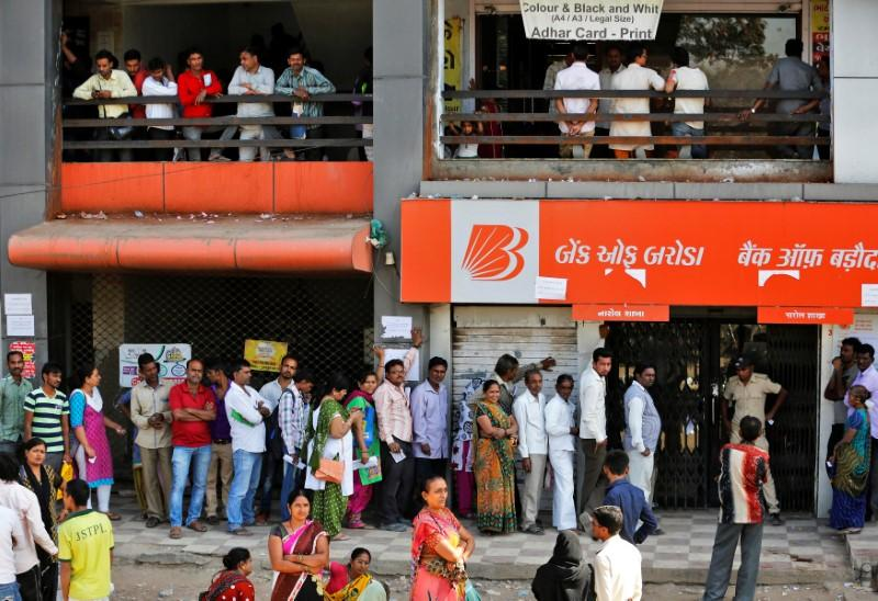 People queue to deposit or withdraw cash outside a bank on the outskirts of Ahmedabad, India, November 29, 2016. Credit: Reuters/Amit Dave/Files