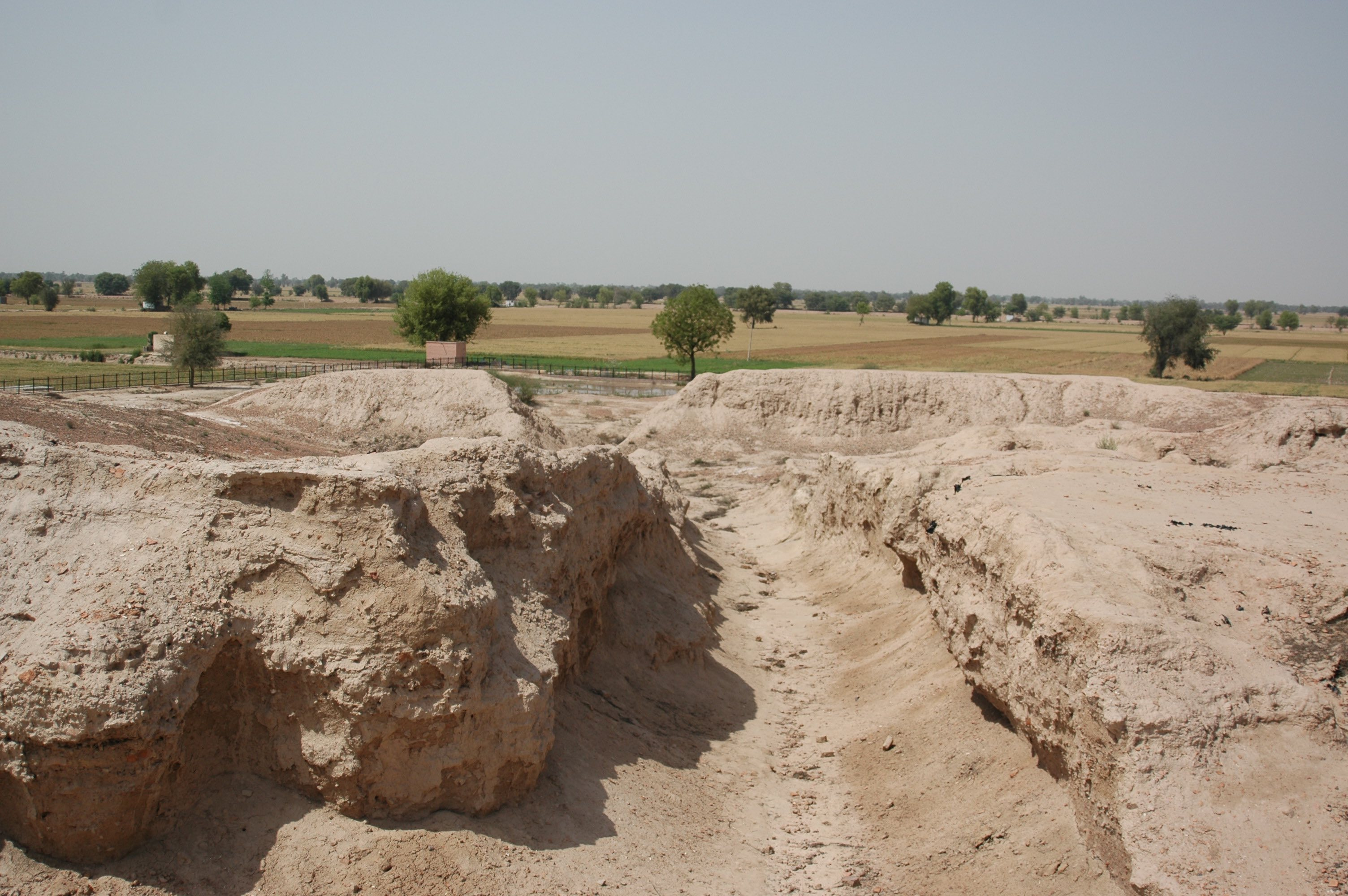 Remnant of a street in the urban centre of Kalibangan. The Ghaggar-Hakra palaeochannel can be seen in the distance. Credit: S. Gupta (Imperial College London)