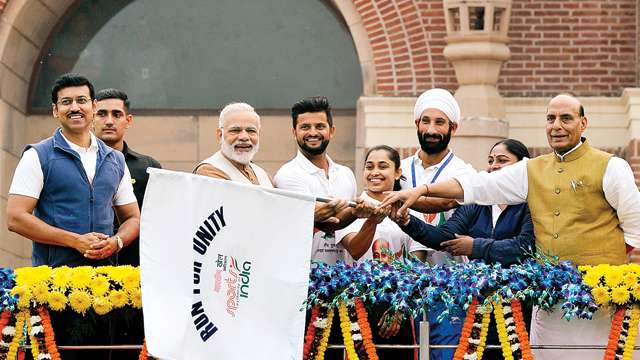 Prime Minister Narendra Modi flags off the 'Run for Unity'. Credit: PTI