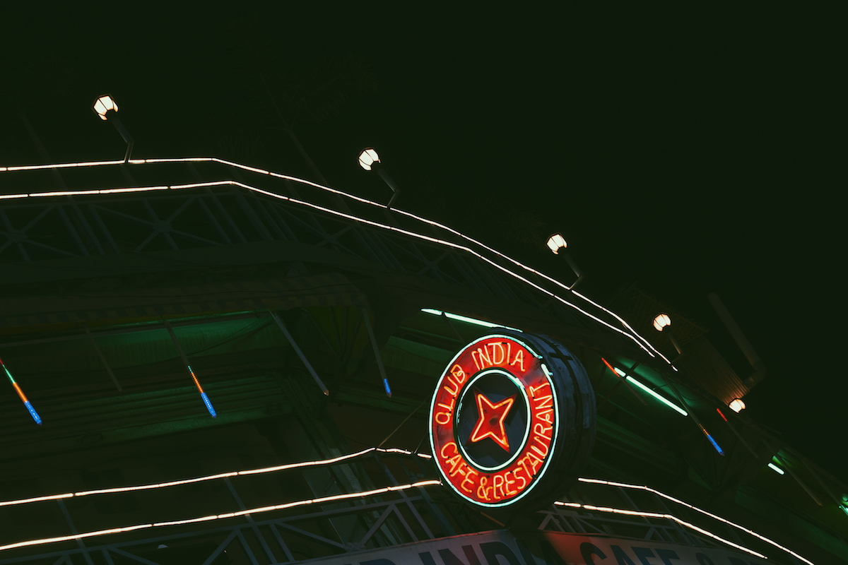 """One of the only circular neon signs in Paharganj. The sign reads: """"Club India Bar and Restaurant"""""""