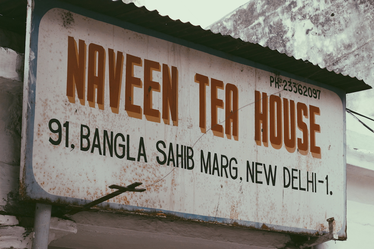 Naveen Tea House, Gole Market. The phone number painted on the right hand side of the board is from a time when Delhi still used numbers with seven digits.