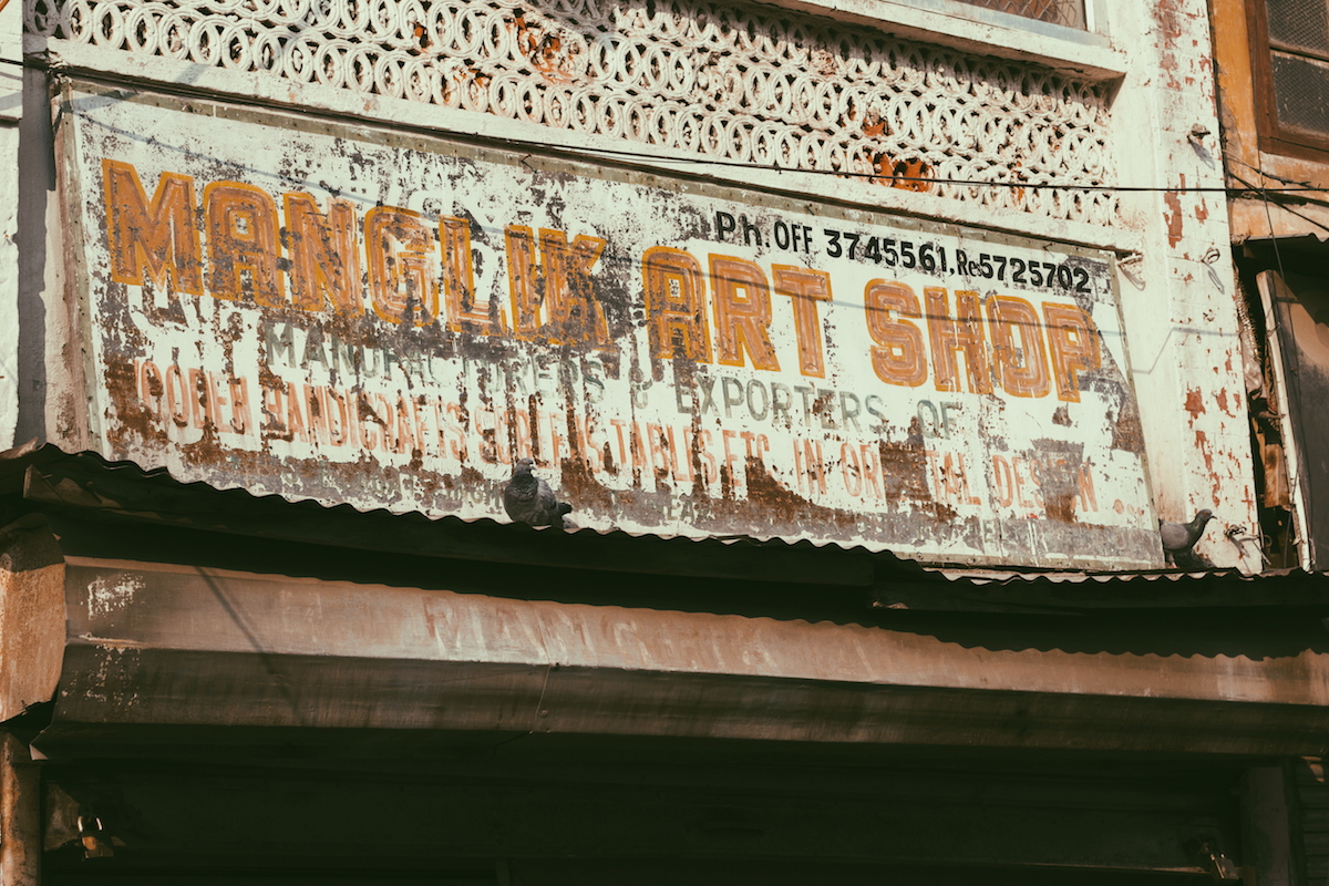 Manglik Art Shop, Gole Market. The painter has marked the outline of the letters with a different colour.