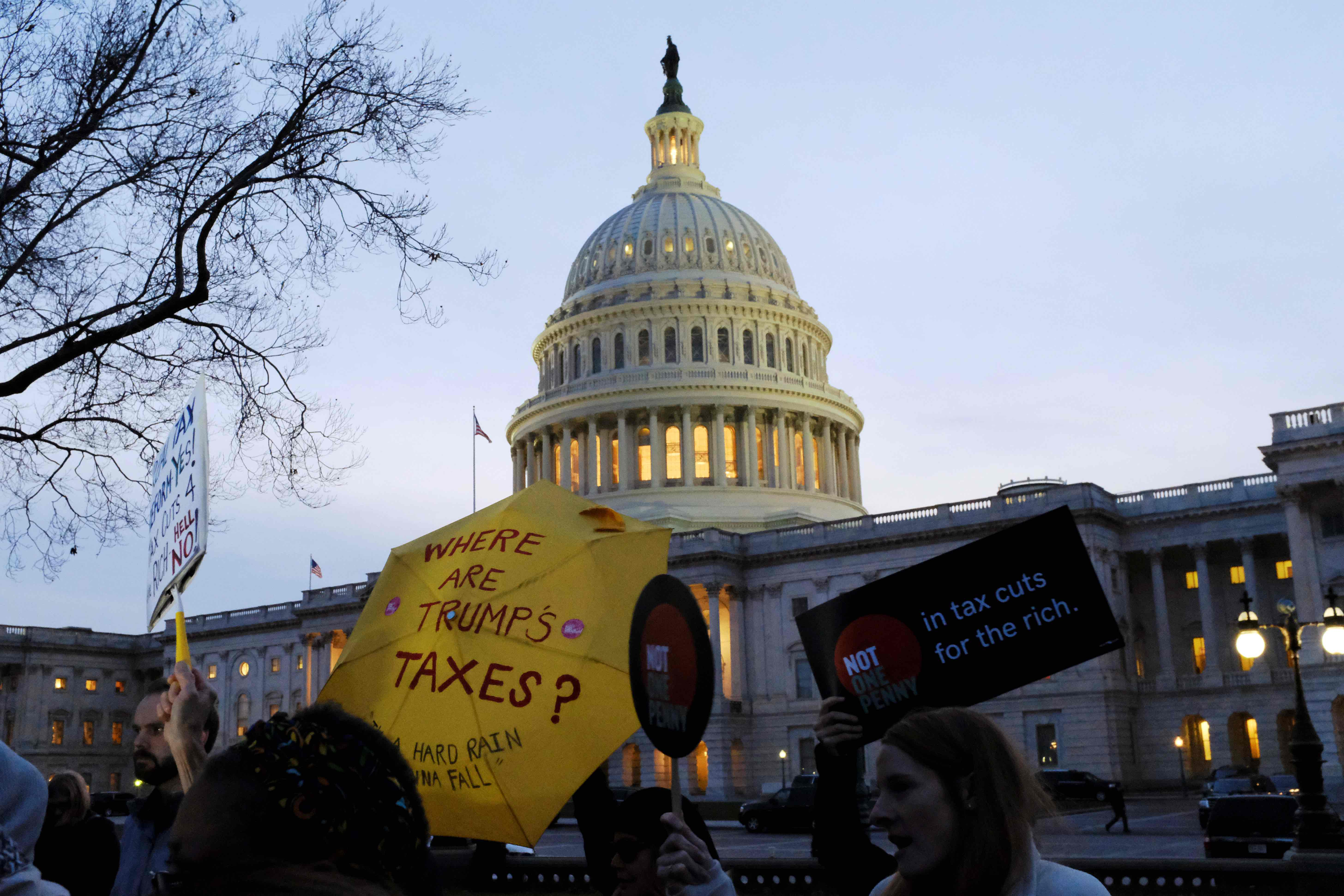 Demonstrators gather outside the US Capitol to protest the Republican tax plan as it works through the Senate in Washington November 30, 2017. Credit: Reuters/James Lawler Duggan