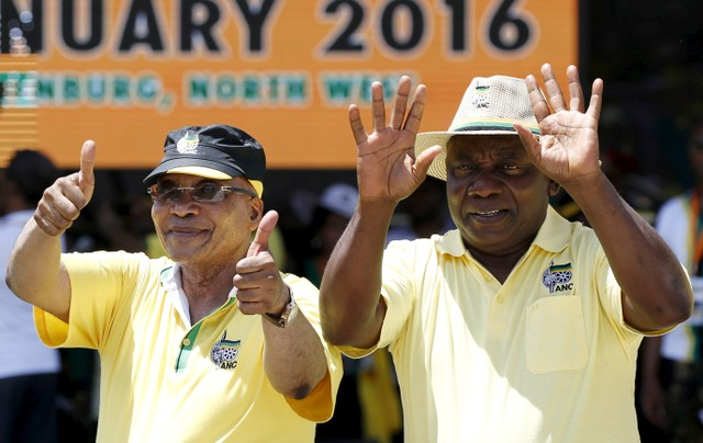 FILE PHOTO: South Africa's President Jacob Zuma (L), gestures next to his Deputy President Cyril Ramaphosa during the party's 104th anniversary celebrations in Rustenburg , South Africa, January 9, 2016. Credit: Reuters/Siphiwe Sibeko/File Photo