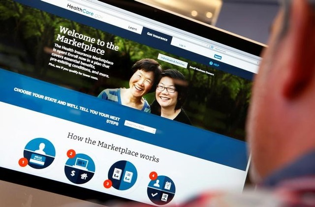 A man looks over the Affordable Care Act (commonly known as Obamacare) signup page on the HealthCare.gov website in New York in this October 2, 2013 photo illustration. Credit: Reuters/Mike Segar/Files