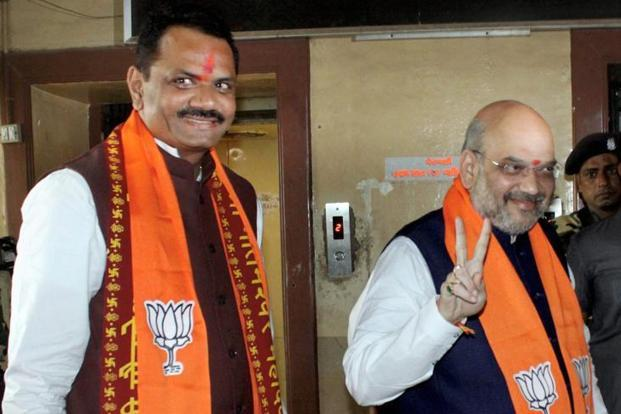 BJP Gujarat president Jitu Vaghani with Amit Shah. Credit: PTI/Files