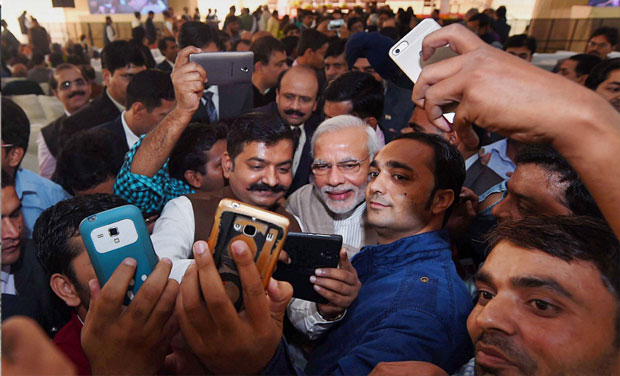 Prime Minister Narendra Modi poses for selfies with reporters during the Diwali Mangal Milan at BJP headquarters in New Delhi. Credit: PTI/Files