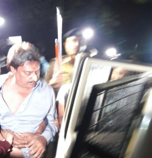 Indranil Rajguru being taken into police custody. Credit: Damayantee Dhar