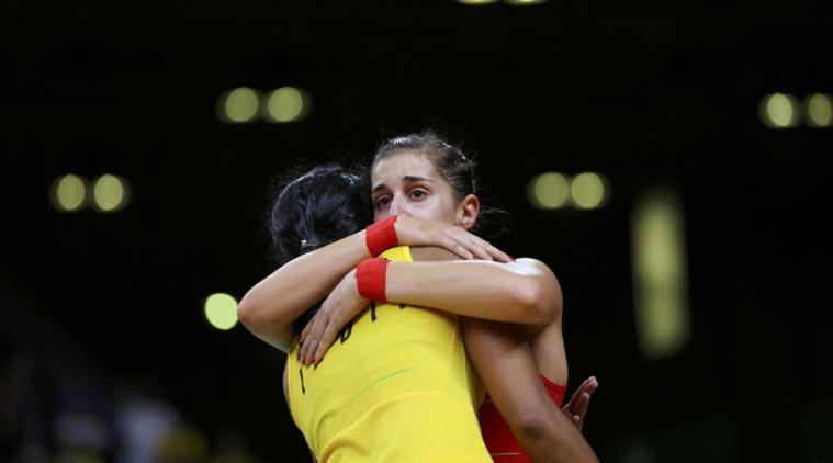 Carolina Marin of Spain hugs PV Sindhu of India after winning the gold medal match in the Rio Olympics. Credit: Reuters