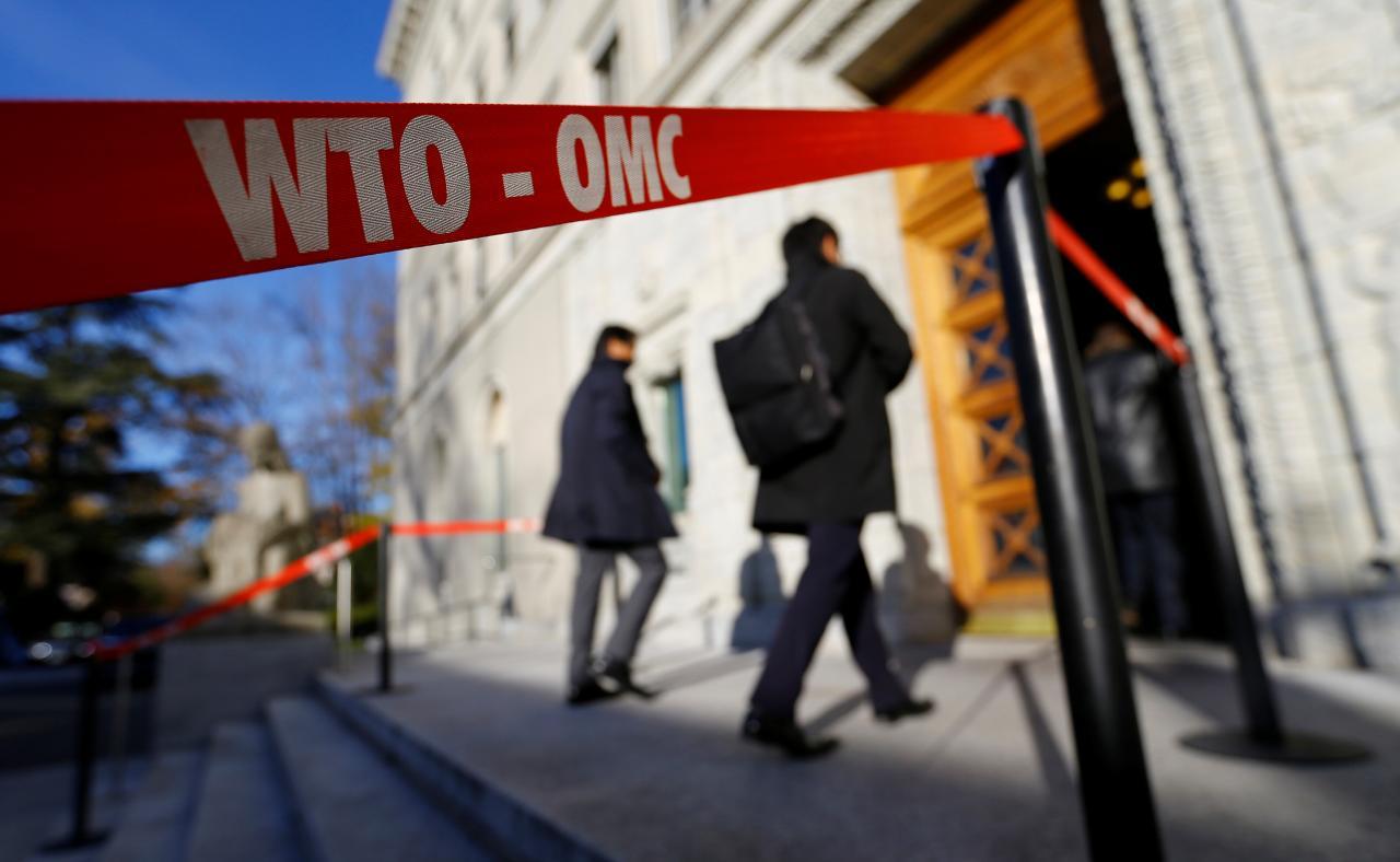 Delegates arrive at the World Trade Organization (WTO) headquarters in Geneva, Switzerland November 22, 2017. Credit: Reuters/Denis Balibouse
