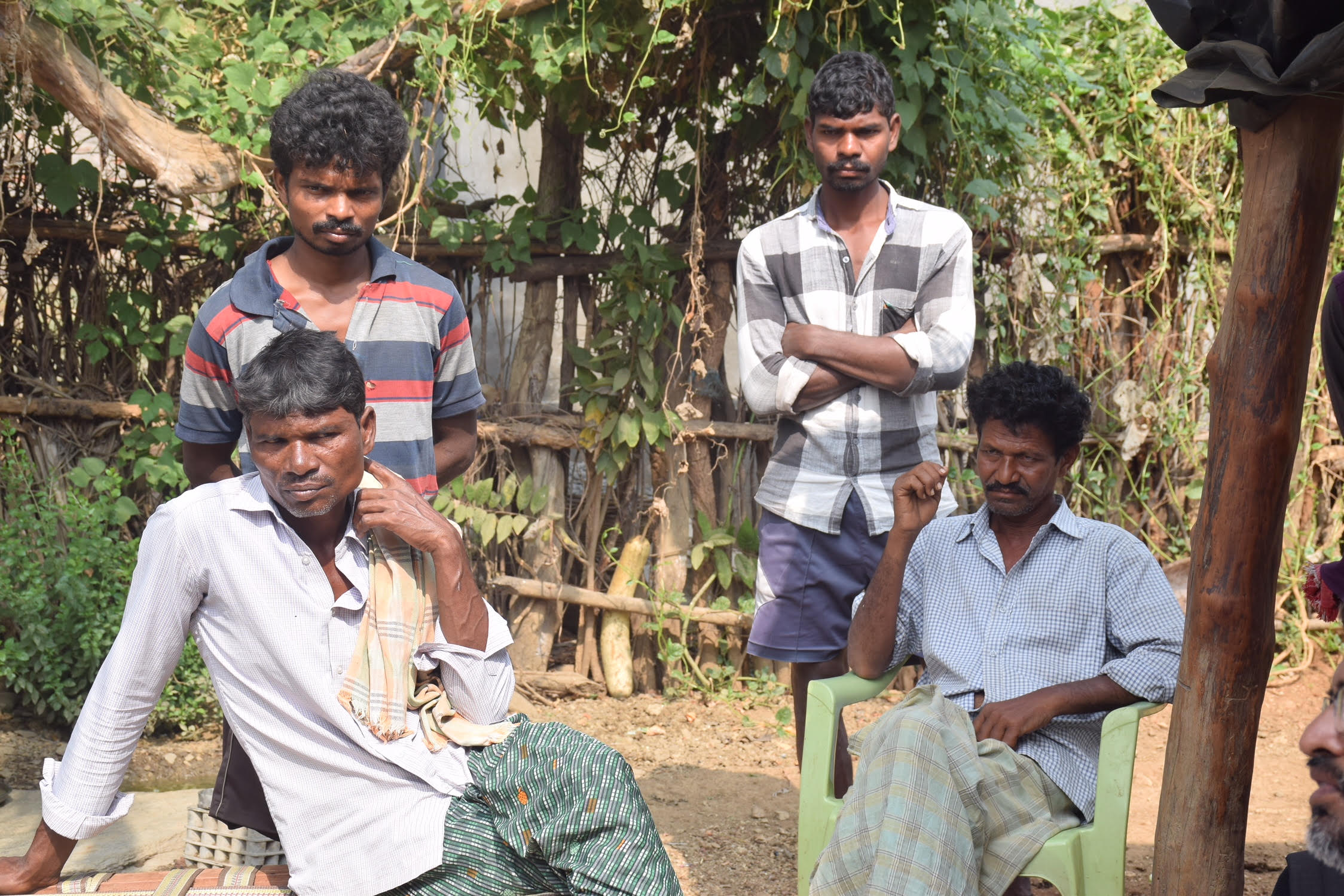 Battu Adinarayana's brother Narayana (sitting left) at their house in Gattumala village in Bhadradri Kothagudem district in eastern Telangana. Credit: Sukanya Shantha