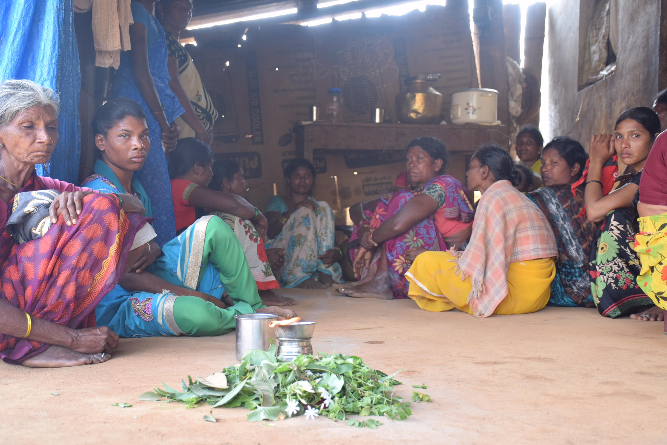 Etti Seenu's wife Kaushalya and other women mourn his death at his house in Marigudem village. Credit: Sukanya Shantha