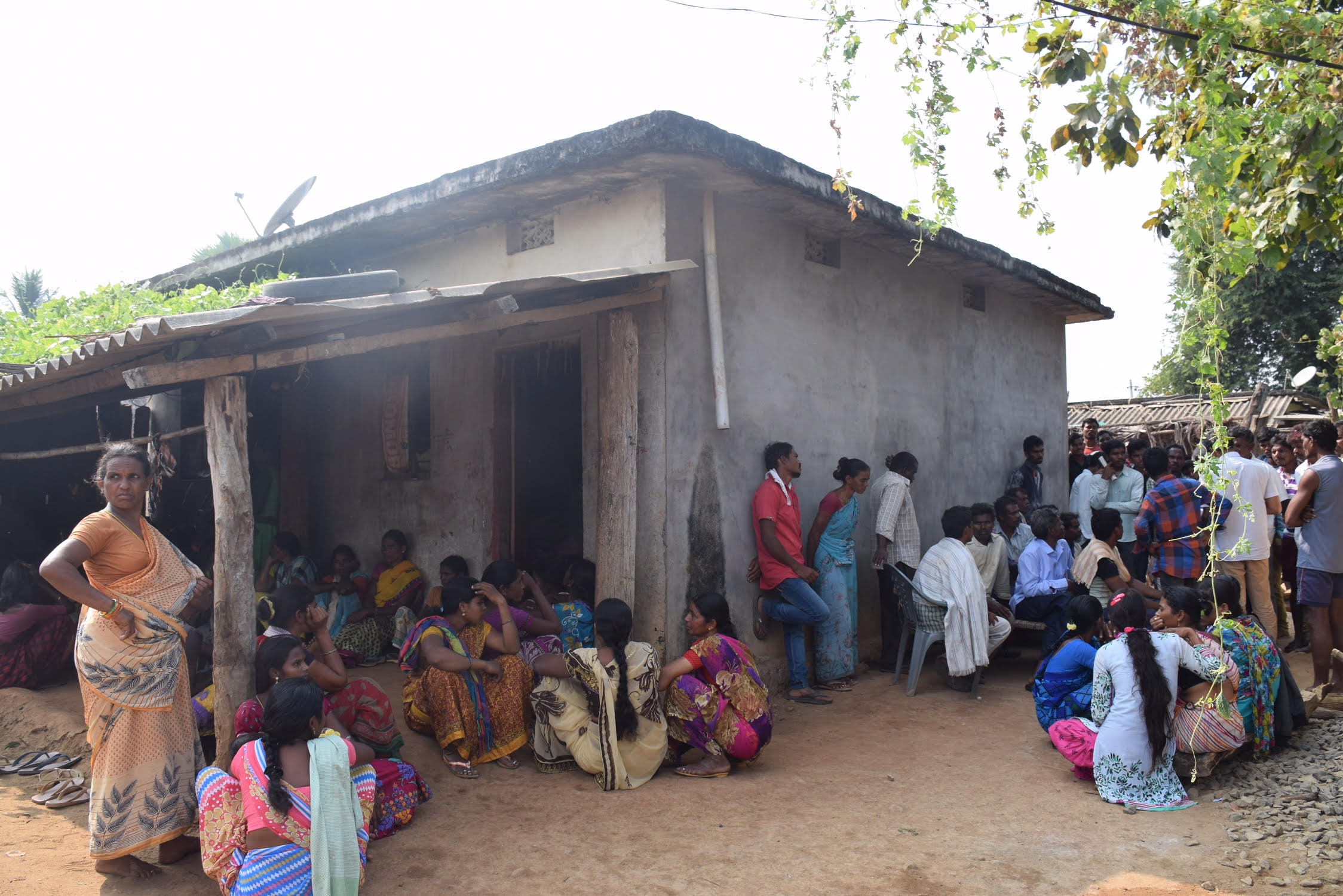 Relatives of Etti Seenu gather at his house in Marigudem village. Seenu was cremated on Friday. Credit: Sukanya Shantha