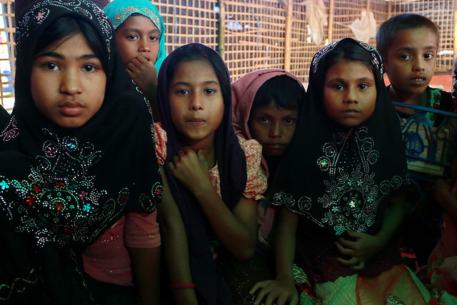 Rubina (far left) along with her friend at the Islamic School at Kutupalong camp, home to Rohingya refugees from Myanmar. Credit: Farid Ahmed/IPS
