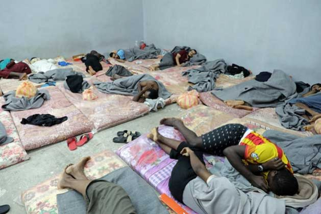 In Libya, dozens of migrants sleep alongside one another in a cramped cell in Tripoli's Tariq al-Sikka detention facility. Credit: UNHCR/Iason Foounten