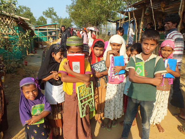 A group of Rohingya children emerge from a nearby religious school in Kutupalong camp. Credit: Naimul Haq/IPS