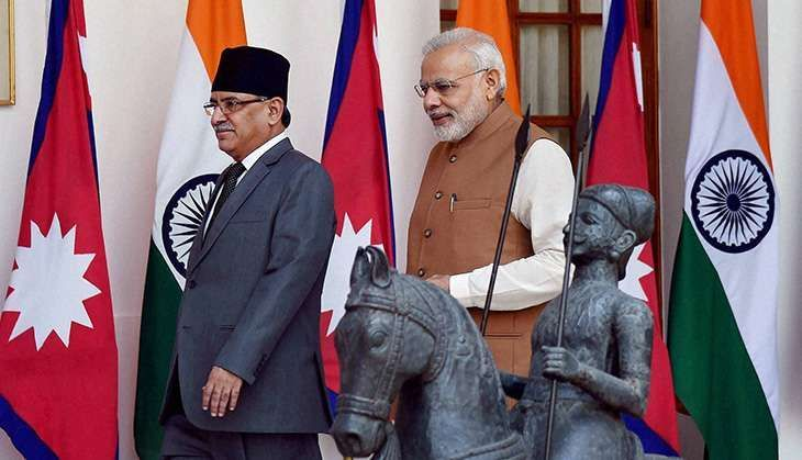 Leader of CPN-Maoist and former Prime Minister of Nepal Pushpa Kamal Dahal (left) with Prime Minister Narendra Modi. Credit: Reuters