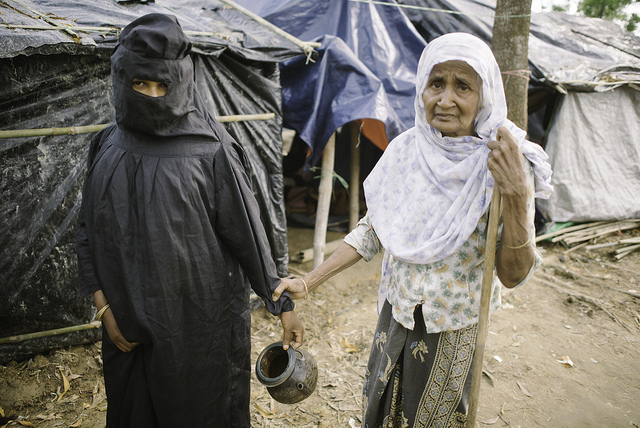 Rohingya women of Balukhali camp embarking on the trek to the toilets. Credit: Umer Aiman Khan/IPS
