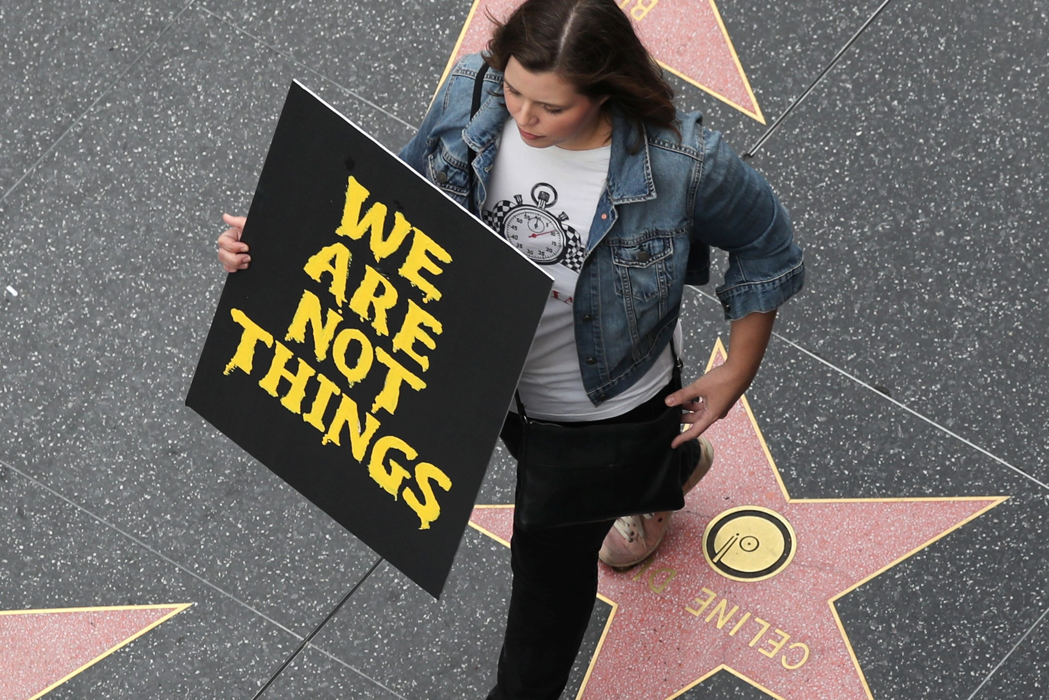 A demonstrator takes part in a #MeToo protest march for survivors of sexual assault and their supporters on the Hollywood Walk of Fame in Hollywood, Los Angeles, California US November 12, 2017. Credit: Reuters/Lucy Nicholson