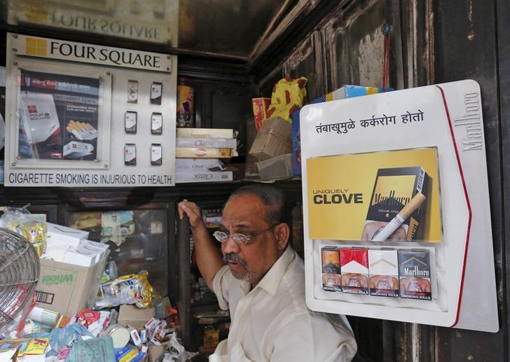 A shopkeeper selling cigarettes waits in his store at a market in Mumbai, India, January 6, 2016. Credit: Reuters/Shailesh Andrade