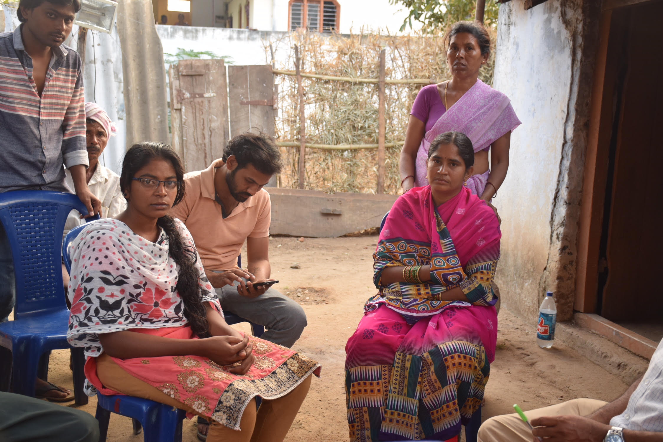 Nunawath Arjun's sister Swati (sitting left) and his aunt Chandini Islawat (sitting on the right) have alleged that he was tortured before he was killed. Credit: Sukanya Shantha